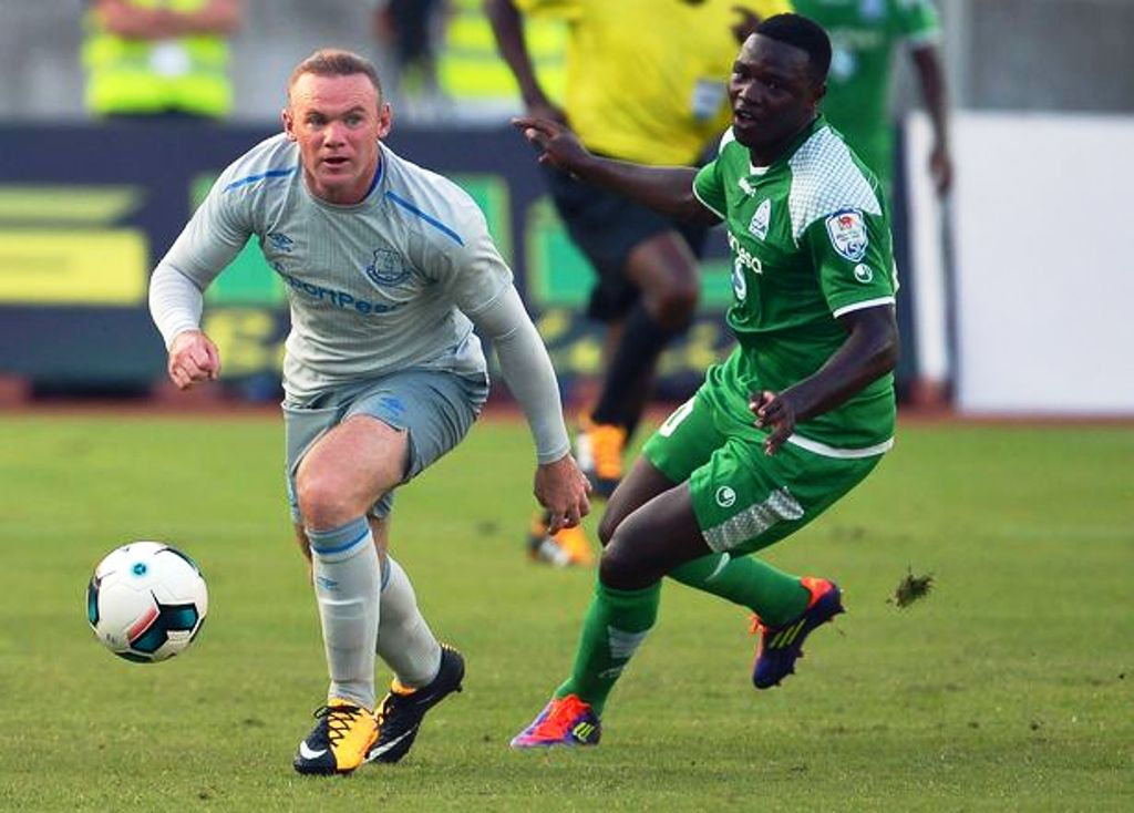 Ernest Wendo keeps tabs on England great Wayne Rooney at National Stadium, Dar Salaam last year. Everton won 2-1