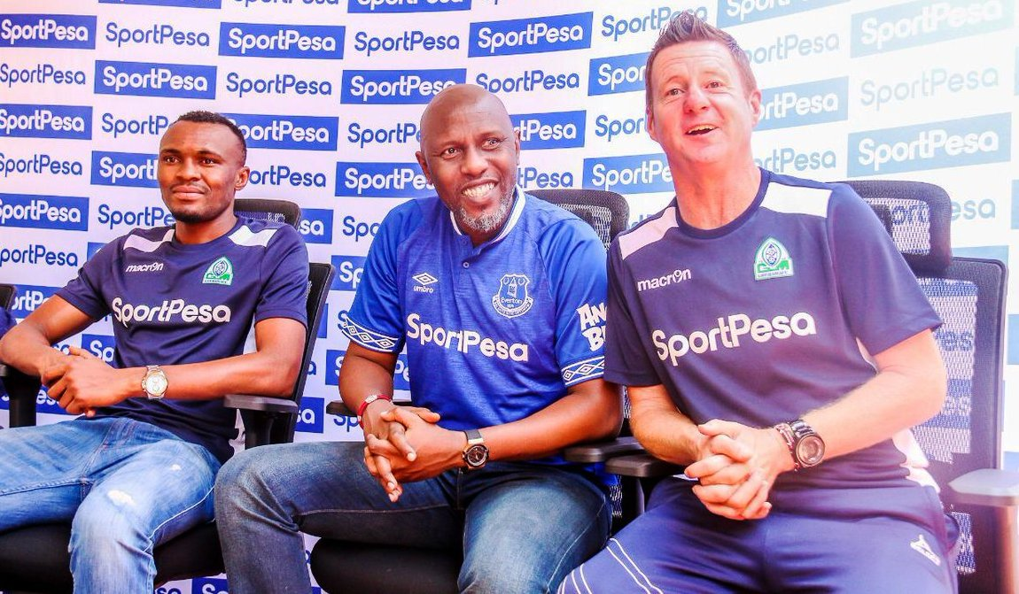 Gor Mahia coach Dylan Kerr (right) when the trip to England was being planned. At left is Gor's Rwanda international Jacques Tuyisenge and centre, Kevin Twissa, chief marketing officer of sponors SportPesa