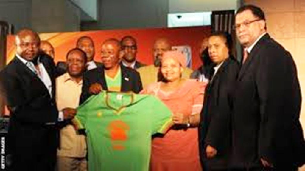 Ndaye Mulamba being honured with replica of the old Zaire shirt before the 2010 World Cup in South Africa by Ghana great Pele Ayew (left) and South Africa football boss Danny Jordaan (right)