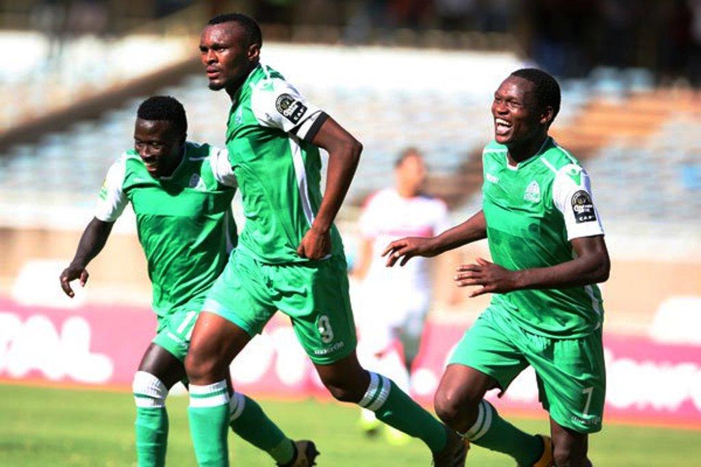 Gor Mahia's Jacques Tuyisenge (centre) celebrates his goal with Boniface Omondi (left) and Nicholas Kipkurui (right) join Rwanda international Jacques Tuyisenge to celebrate one of his goals against Zamalek at Kasarani