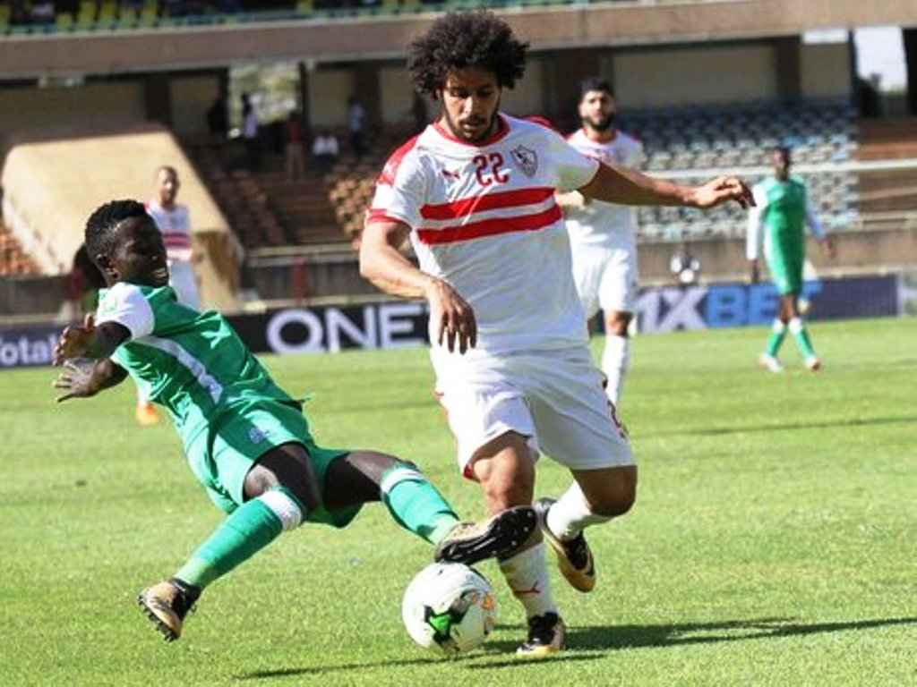 Abdallah Saleh of Zamalek (right) is tackled by Boniface Omondi