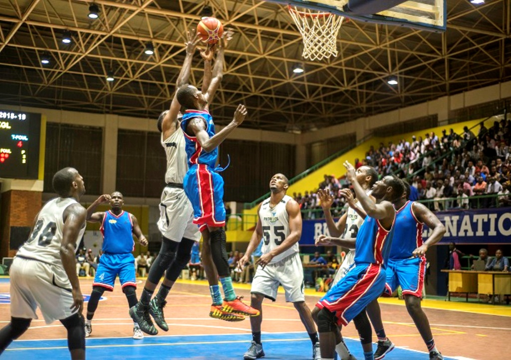 A league match in Kigali and below, Rwanda President Paul Kagame launches a basketball programme