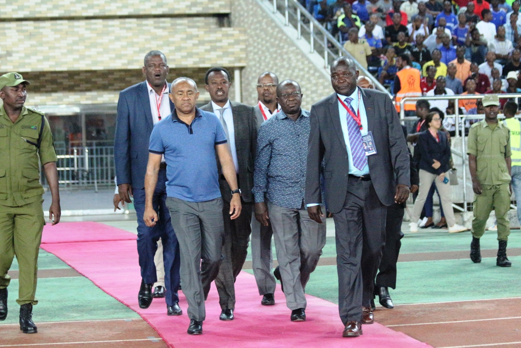 CAF President Ahmad (in blue T shirt) steps out at the National Stadium, Dar es Salaam for the U17 AFCON qualifier final last year