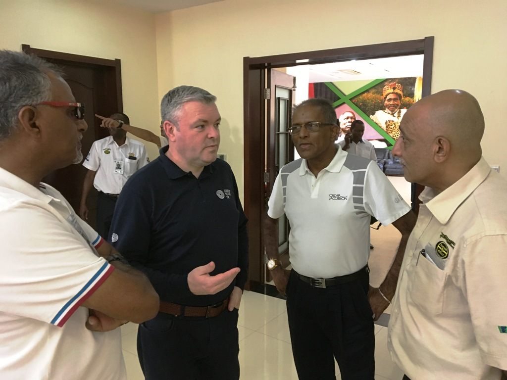 Ian Campbell (centre) at Moi International Sports Centre on Wednesday talks to organisers and media including, from left Anwar Sidi, a Safari deputy clerk of the course, Abdul Sidi a motorsport correspondent and Nizar Yakub, a deputy clerk of the course