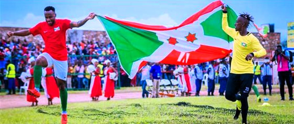 In Bujumbura on Saturday, players carry the Burundi flag to their first ever AFCON Finals after defeating Gabon 1-0