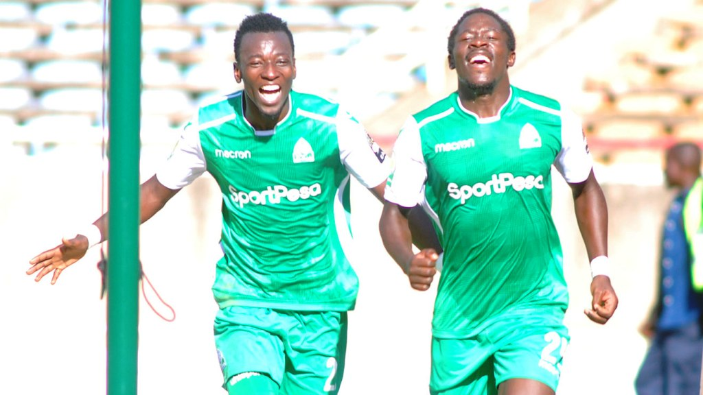 Are they good enough to prop up Gor Mahia after Jacques Tuyisenge departure? From Rwanda international Francis Mustapha (left, with Lawrence Juma) a lot more is expected now. Below: In meantime goal-getting role filled by veteran Kenya international Dennis Oliech (left) here against Petro Atletico of Angola in a CAF Confederation match at Moi International Sports Centre, Kasarani