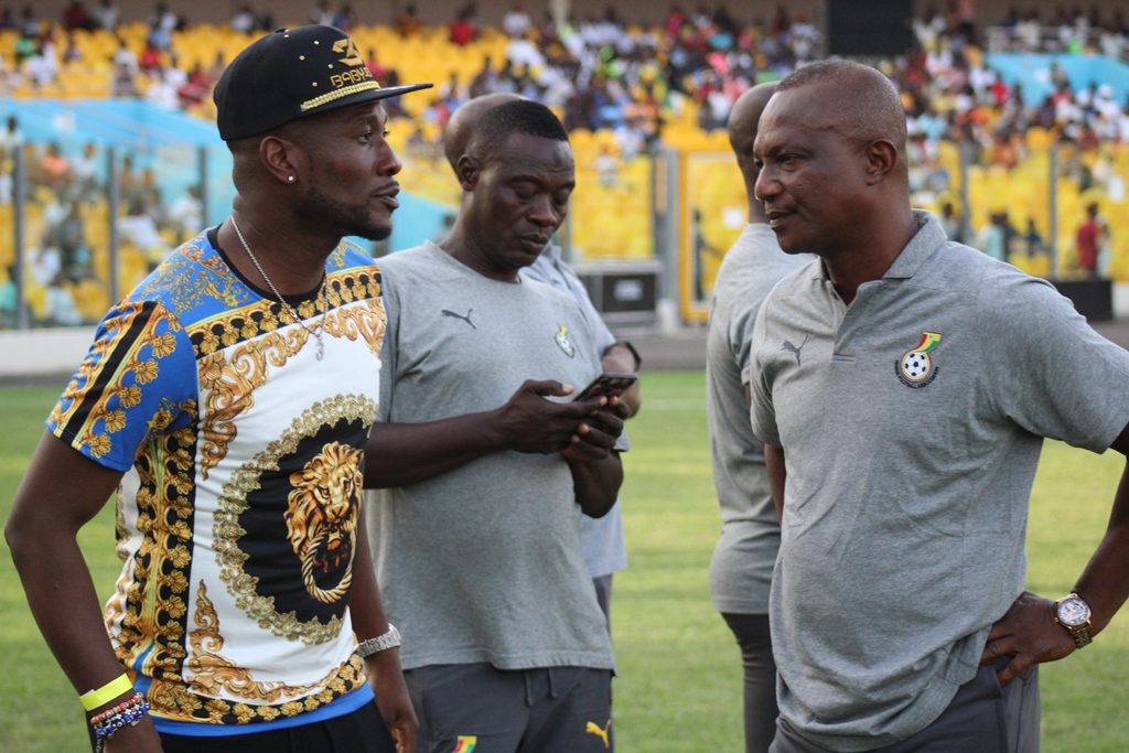 Regular Ghana skipper Asamoah Gyan (left) had no part to play on the pitch on Sunday but he came out to support the Black Stars including coach James Kwesi Appiah (right)