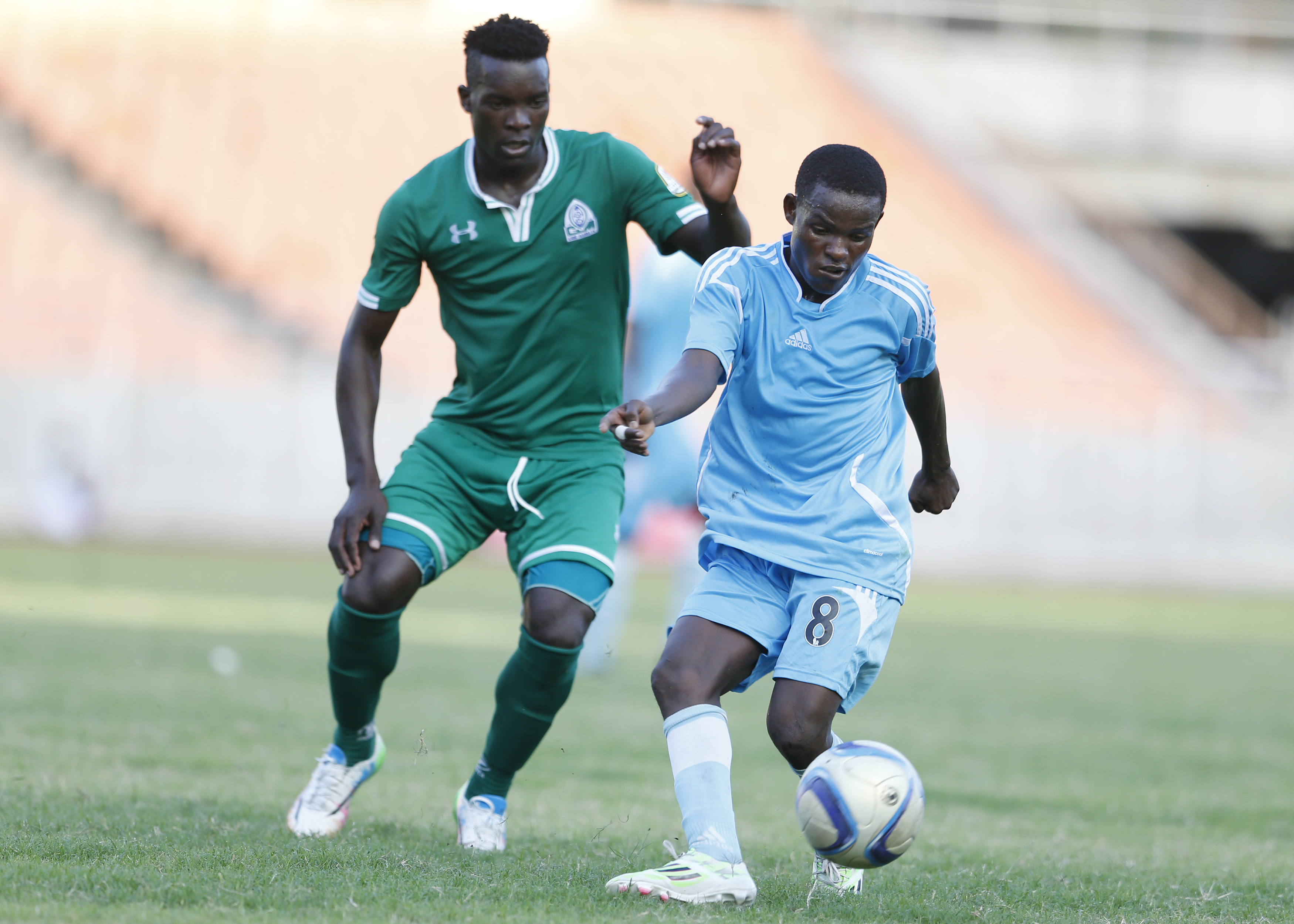 Khalid Aucho (left) of Gor Mahia challenges Juma Mbwana Faki of Zanzibar's KMKM during their Cecafa Kagame Cup club championship match at the National Stadium in Dar-es-Salaam on July 20, 2015. Aucho, now of Church Hill Brothers FC, India is in the Uganda Cranes squad for the 2019 AFCON