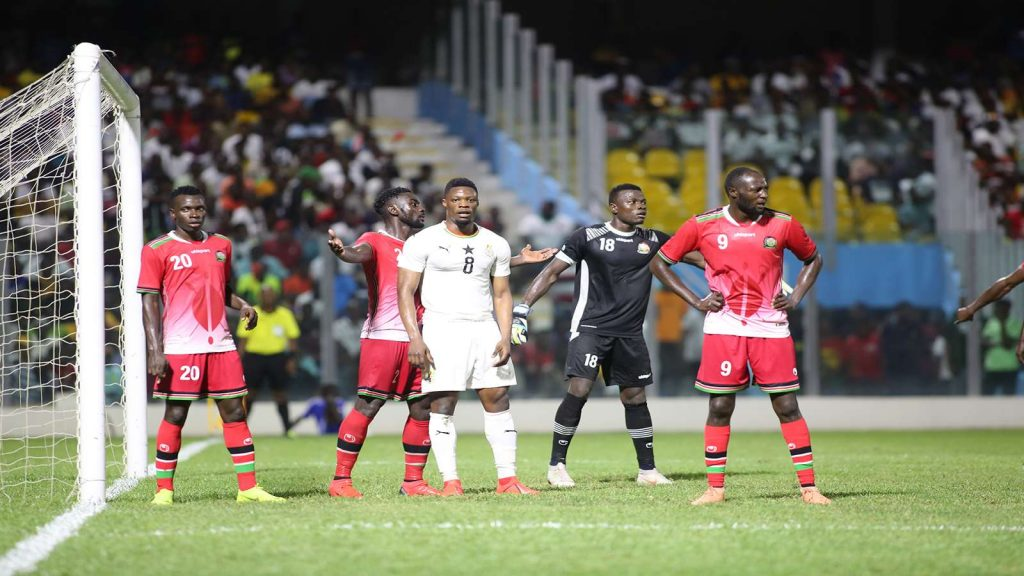 Harambee Stars of Kenya (red) make a defensive stand against Ghana in Accra on Sunday