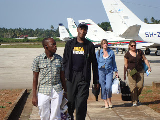 Danny Glover arrives in Zanzibar (above) for a film festival; and, below at a social gathering with Zanzibaris