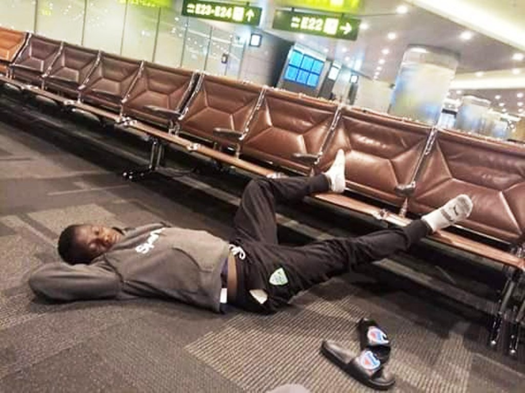 Another Gor Mahia player sprawled on airport terminal floor