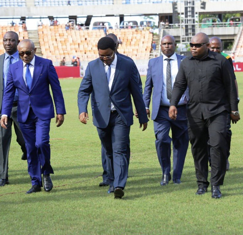 TOP: Ahmad Ahmad (right) at Azam Complex, Chamazi, before an AFCON U17 match on Monday, with Wallace Karia (second from left) President of Tanzania Football Federation accused, together with Cape Verde, of having received Sh2million bribe from Ahmad. Above: The CAF President Ahmad (second from left) with Tanzania Prime Minister Kassim Majaliwa (third from left) at the National Stadium Dar es Salaam on Sunday to launch U17 AFCON