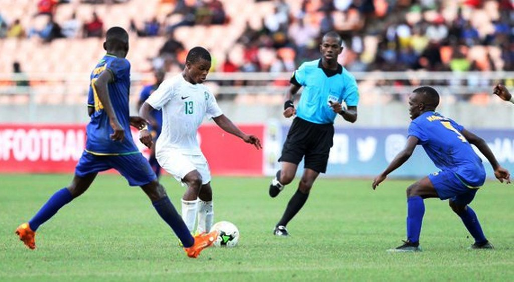 TOP: Nigeria's Wisdom Onyedikachi Ubani shoots at Tanzania in the 2019 AFCON U17 opener at National Stadium Dar es Salaam on Sunday. Above, more Nigeria possession against Tanzania
