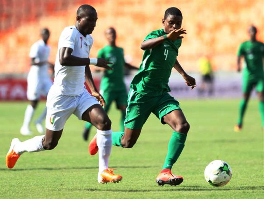 Top: Cameroon's Saidou Alioum Moubarak (7) keeps off Jose Cabingano of Angola during their semi-final clash at National Stadium, Dar es Salaam on Wednesday and Above: Alya Toure (7) of Guinea against Samson Tijani of Nigeria in the other semi-final at the same venue