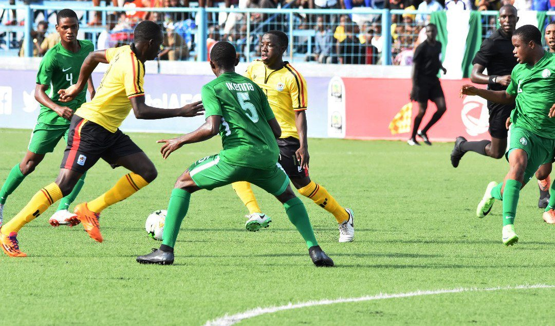 Nigeria's Ikenna (No. 5) and Tijani (left) keep tabs on Uganda during their match on Saturday at Azam Sports Complex, Chamazi