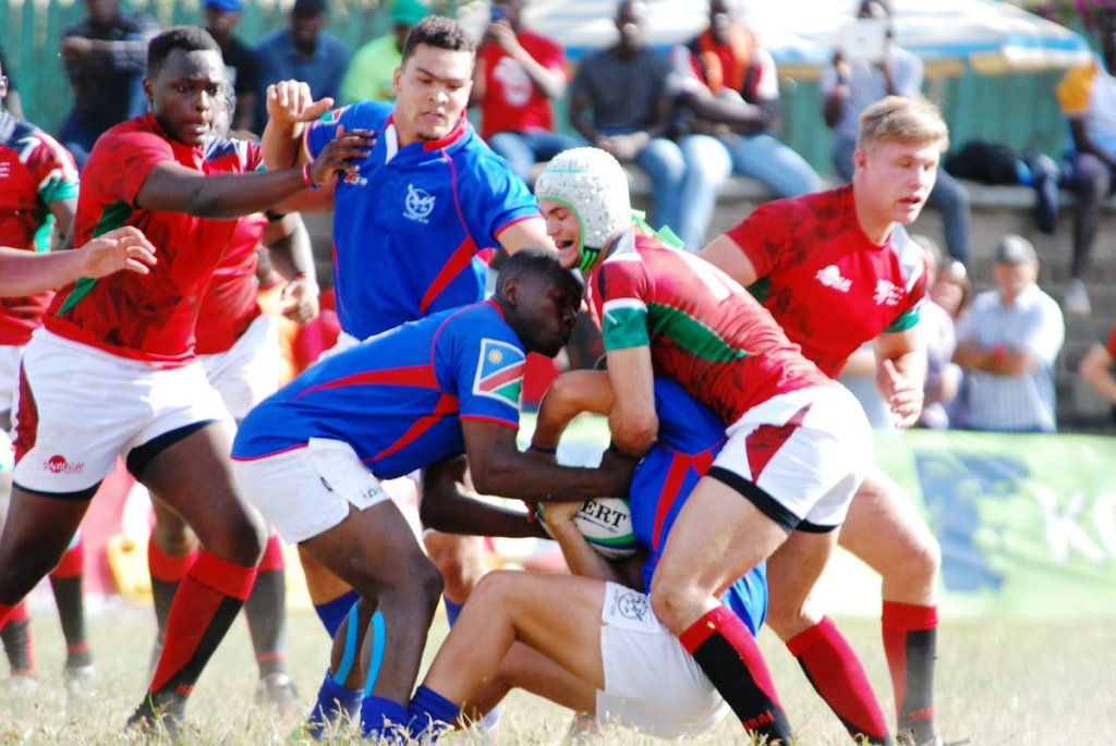 Kenya get into the grind for ball possesion against Namibia on Saturday