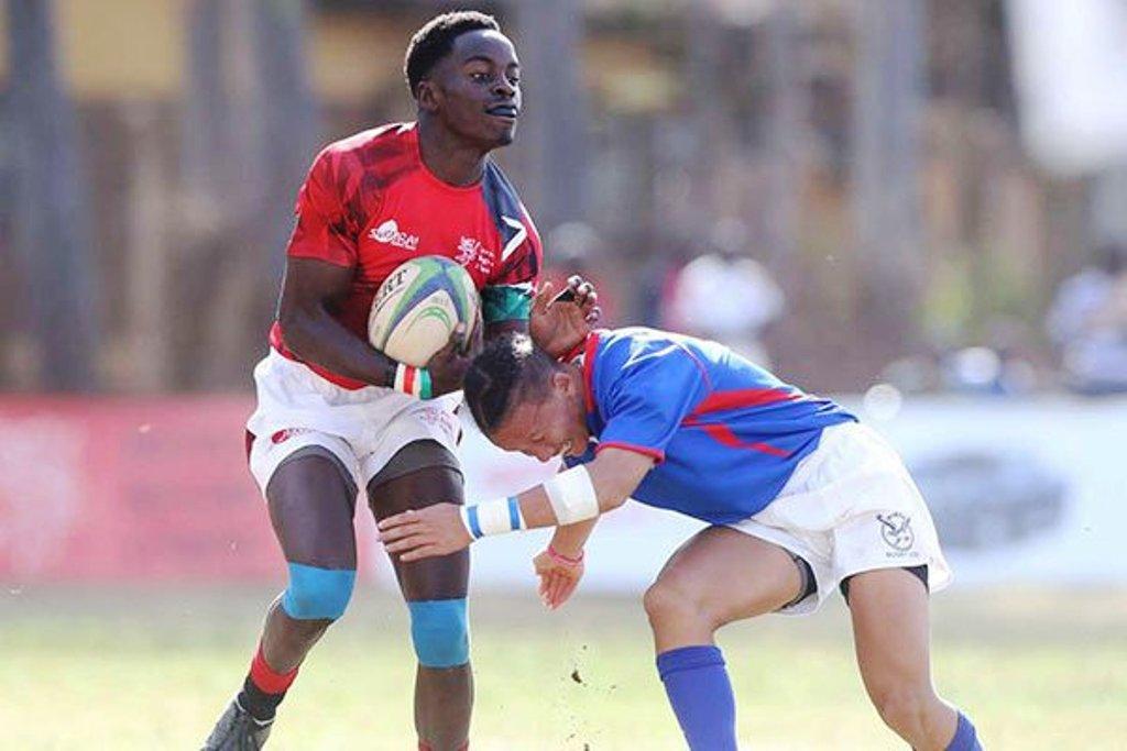 Man-of-the-match Kenya's Matoka Matoka (left) fends off a tackle from Namibia's Aljerreau Zaahl