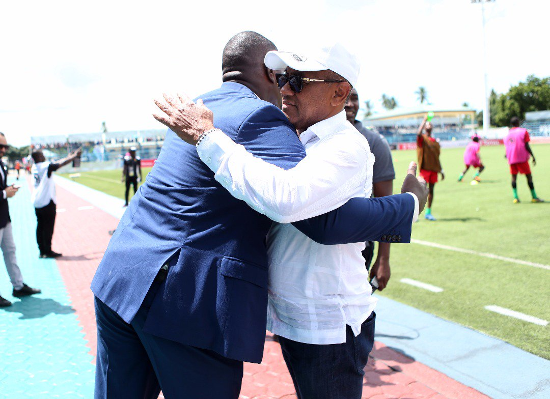 Ahmad (right) the CAF President with a match official at Azam Sports Complex during Monday's programme