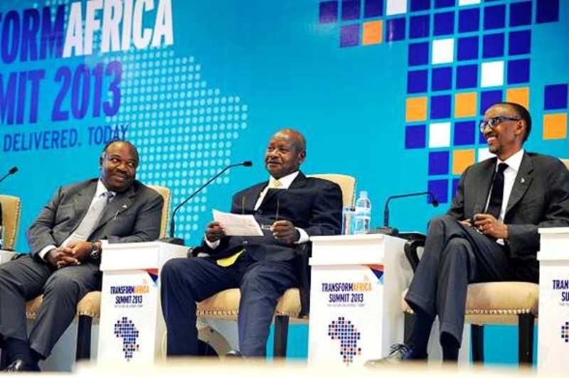 Uganda President Yoweri Museveni (centre) flanked by Rwanda's Paul Kagame (right) at the annual (2013) Transform Africa Summit