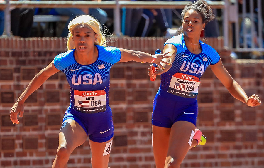The US women's team exchange the baton at the Penn Relays