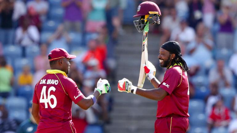 Chris Gayle (right) the day he struck his 25th ODI hundred