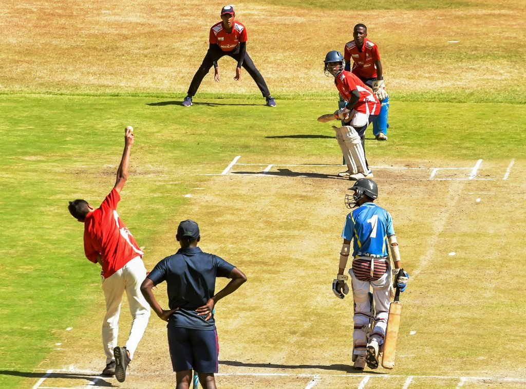 Top and above: Bowling and batting exercises at Nairobi Gymkhana during the Gary Kirsten Cricket high performance training camp