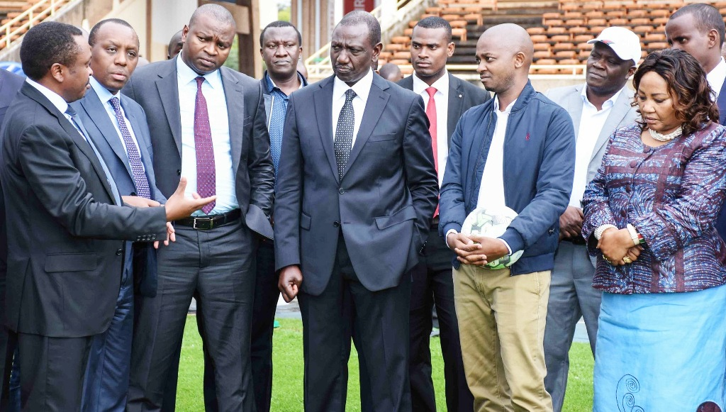Frederick Muteti (left), chairman of the Sports Kenya Board, at Moi International Sports Centre updates Deputy President William Ruto about progress of providing sports infrastructure in the country. But outside Nairobi, in the entire country Sports Kenya-initiated stadium building projects have stalled
