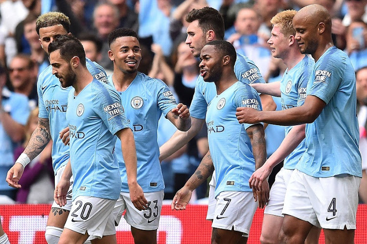 Above: Manchester City's English midfielder Raheem Sterling (3rd from right) celebrates with teammates after scoring the team's fifth goal during the English FA Cup final with Watford at Wembley Stadium in London, on May 18 Top: Man City at trophy celebrations