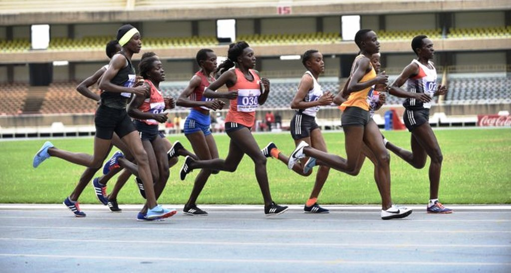 At this point of the women's 10,000m race, Irene Kamais (030) was in the middle of the park but went on to win ahead of leading Monica Chirchir