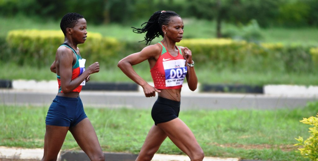 Experienced Grace Wanjiru leads fellow Kenya Defence Forces' soldier Emily Ngii in the women's 20km walk race at the trials in Kasarani Stadium. Ngii won