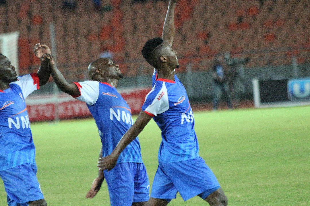 Top: Shaaban Idd Chilunda (right) of Azam scores at the Cecafa Kagame Cup tournament in Dar es Salaam. Azam, above, celebrate another Kagame Cup goal. They will be the defending champions when the tournament takes place in Rwanda, July 6-21, 2019