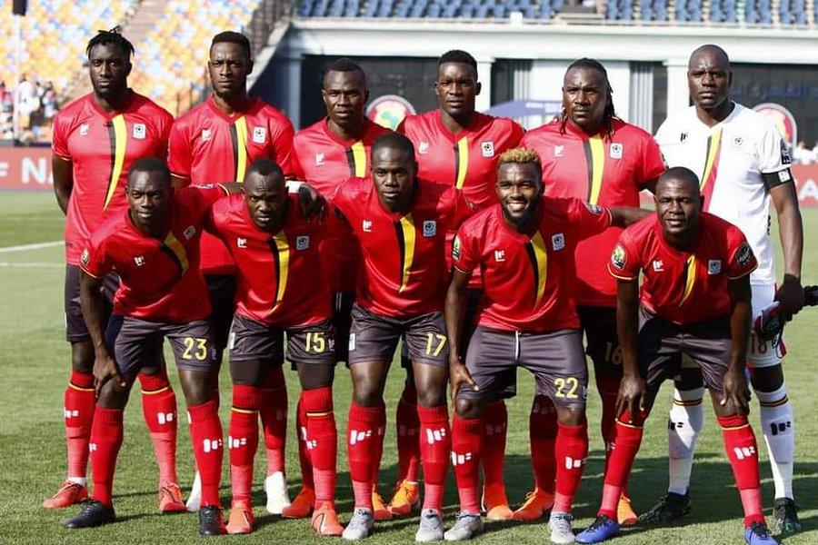 Top: Uganda celebrate Emmanuel Okwi's opening goal against Zimbabwe. Above: The Cranes starting line-up at Cairo International Stadium