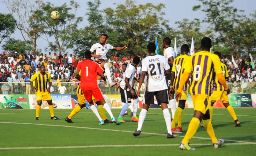 APR of Rwanda, in white, with a header against Proline of Uganda whom they beat