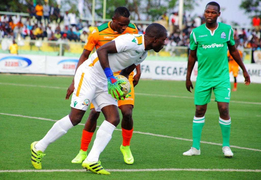 Green Eagles goalie Sebastian Mwange has a safe catch as Gor Mahia's Kenya striker Nicholas Kipkirui (right) accepts it is a lost cause
