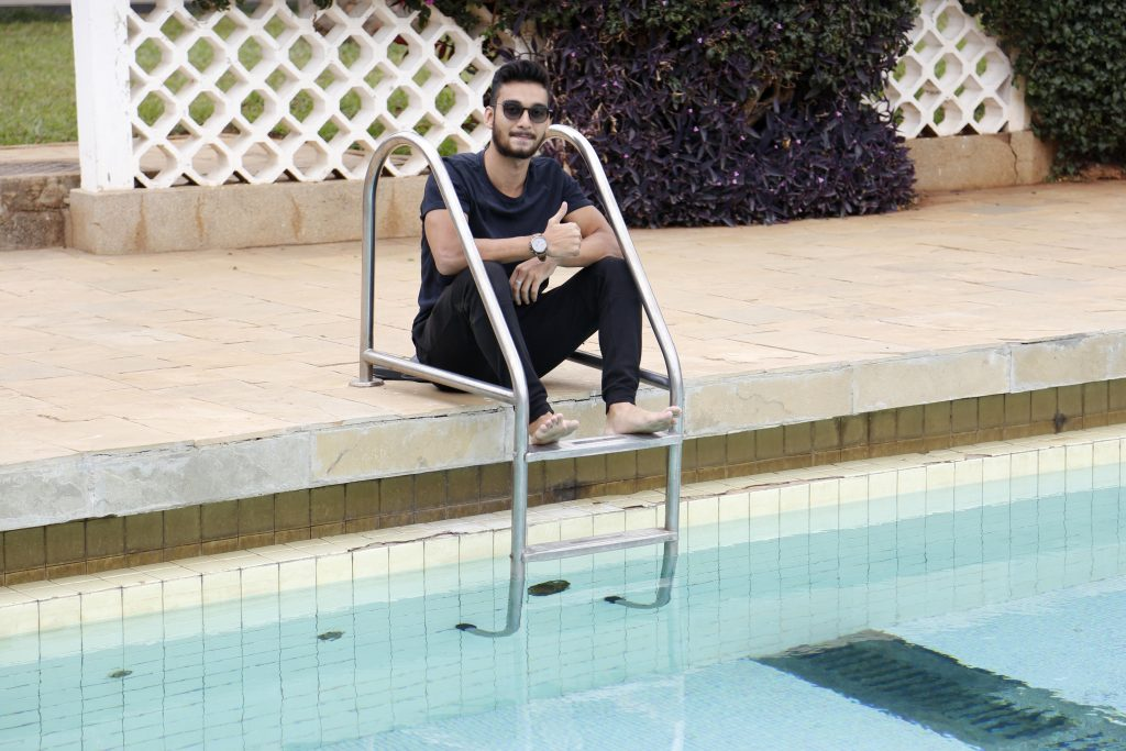 Maahir Harunani of Mombasa 'cooling his heels' at Moi International Sports Centre, Stadion Hotel pool before departure to Rabat. He was the only 'home-based' team member as the rest of Team Kenya swimmers are based in Britain and USA, Photo/MOHAMMED AMIN