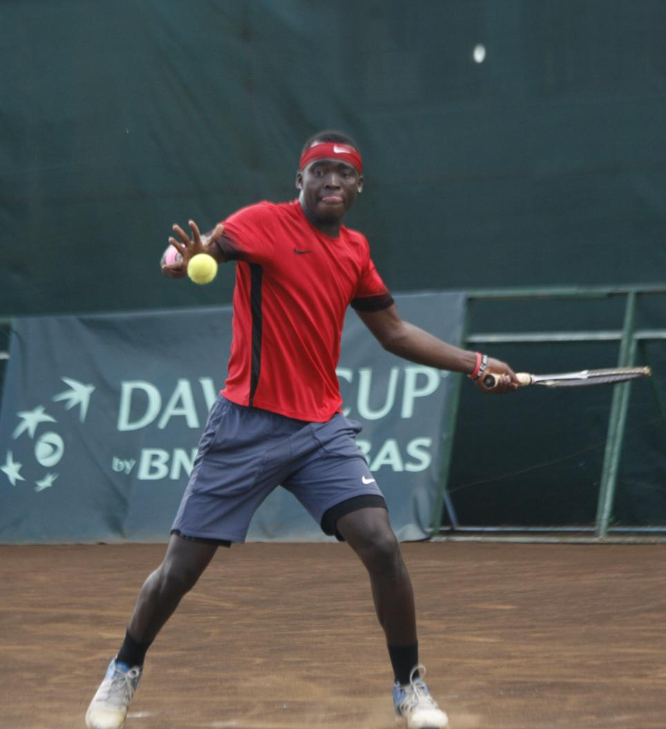 Top: Albert Njogu in an earlier international tournament at Nairobi Club. He had a round of 64 win at the tennis tournament in the 12th African Games in Rabat. Photo/COURTESY. Above: Kenya's top men's player Ishmael Changawa Mzai met with ambush in Rabat, eliminated in the round of 64 by No.4 seed Aziz Dougaz of Tunisia. Photo/COURTESY
