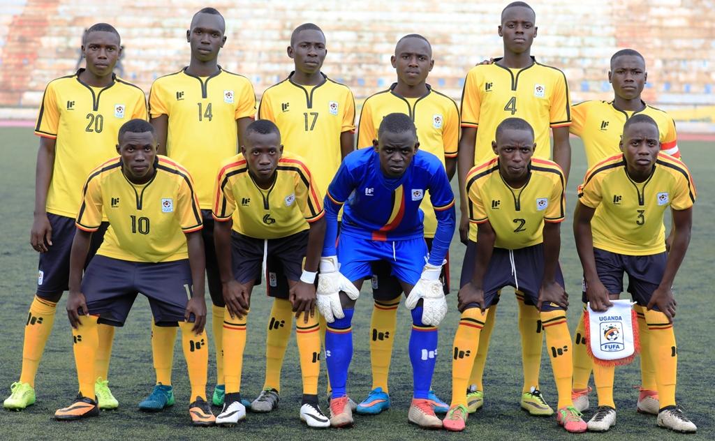 TOP: Uganda (in gold) overwhelm Kenya in an aerial battle during the Final of the U15 Cecafa Challenge Cup in Asmara. Above: Uganda's starters and below, the Kenyans