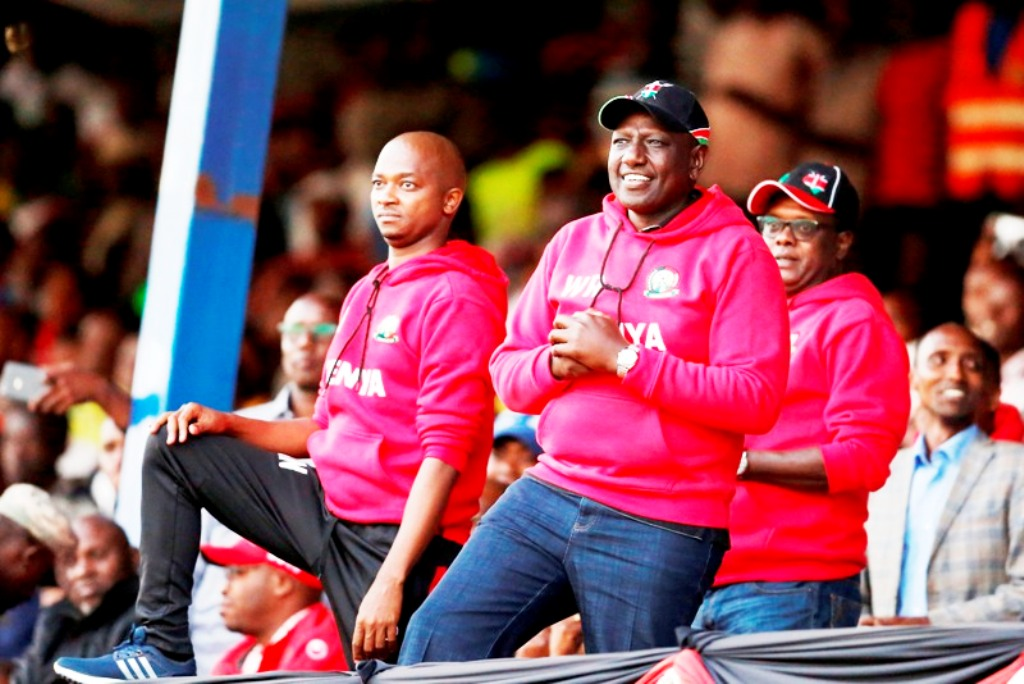 When the country puts up a successful international event, everyone is happy and national morale upbeat … Deputy President William Ruto (nearest to camera in cap) in an excited moment watching the national soccer team, Harambee Stars, on the way to the 2018 Cecafa Challenge Cup at Kenyatta Stadium, Machakos. Below, DP Ruto with Kenya's 800m world record holder David Rudisha. Photos/MOHAMMED AMIN