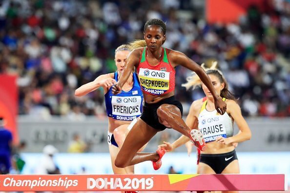 Beatrice Chepkoech goes over the hurdle on her way to victory for Kenya in the women's 3,000m steeplechase in Doha