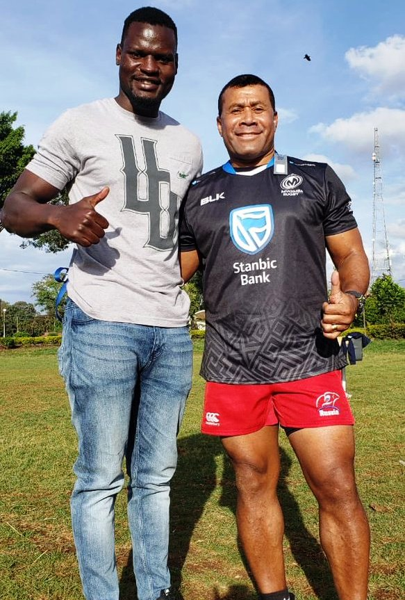 Top and above: Rugby Sevens legend Waisele Serevi (right) was keen on the gear of one of Kenya's leading clubs, Mwamba, home of Kenya's world stars of the game Collins Injera, Humphrey Kayange, Lavin Asego and Horace Owiti. Serevi bought his merchandise from Mwamba player and kit retail agent Chris Asira during training at the University of Nairobi ground on Sunday. Photo/COURTESY