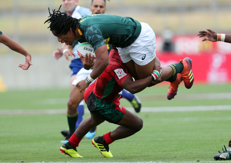 South Africa's Steadman Gans is tackled by a Kenyan player during the HSBC Sevens World Series leg at the Waikato Stadium in Hamilton, New Zealand on January 26, 2019