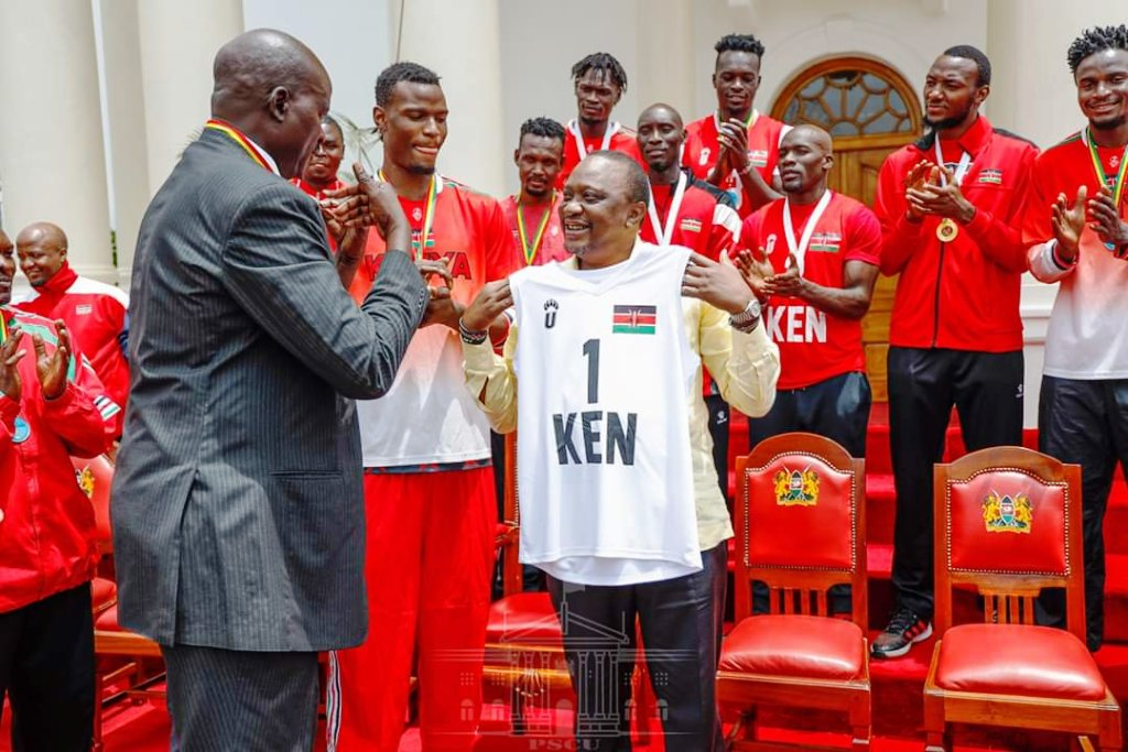 Kenya Basketball Federation head Paul Otula, above, and below with President Uhuru Kenyatta during a national basketball team visit to State House, Nairobi. Kenya dismally failed to leverage on its huge potential to be a center of forthcoming Basketball Africa League driven by American giant sporting organisation NBA (National Basketball Association)