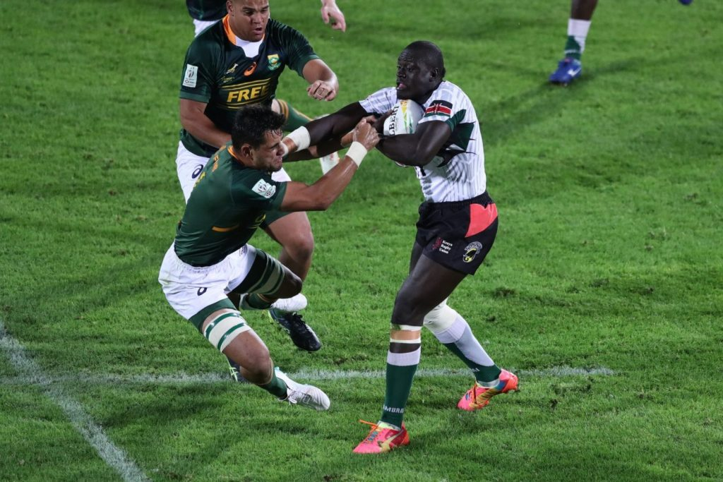 Top: Alvin 'Buffa' Otieno had great outing for Kenya Sevens in Cape Town. Above: 'Buffa' taking on the South Africans. Below: Another Kenyan forward Dan Sikuta