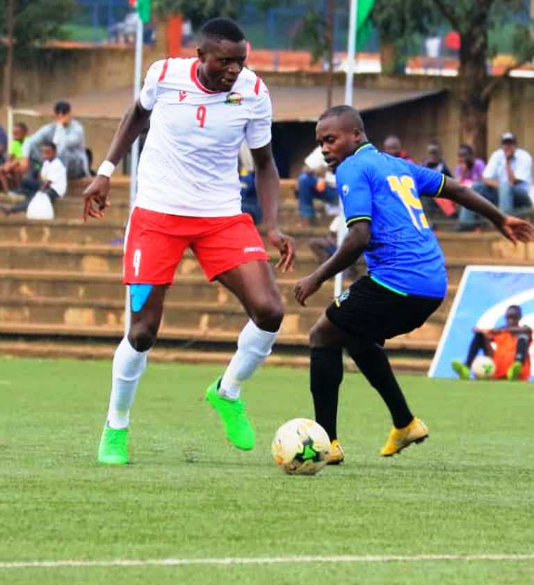 Harambee Stars striker Oscar Wamalwa (left) and Mohammed Hussein of Kilimanjaro Stars face each other at Lugogo