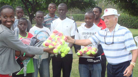 Jim Davies (right) coaching and administration icon of Kenya tennis hands over equipment to Victoria Tennis Academy. He died in Nairobi in 2012. His African Games tennis Gold medallist daughter, Jane, passed way last week