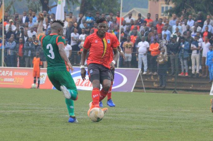 Burundi (left) defending against Uganda on the opening day on Saturday at Lugogo Stadium