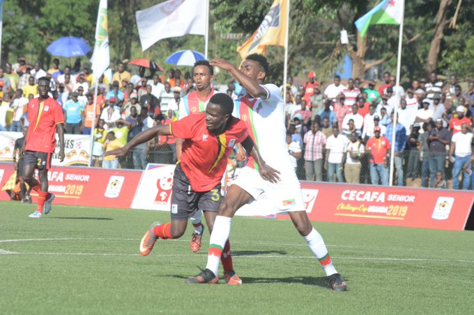 Eritrea (in white) battle in their 0-2 loss to Uganda at Lugogo last Wednesday. But the other results favoured the Eritreans who qualified for Tuesday's semi-finals against Kenya