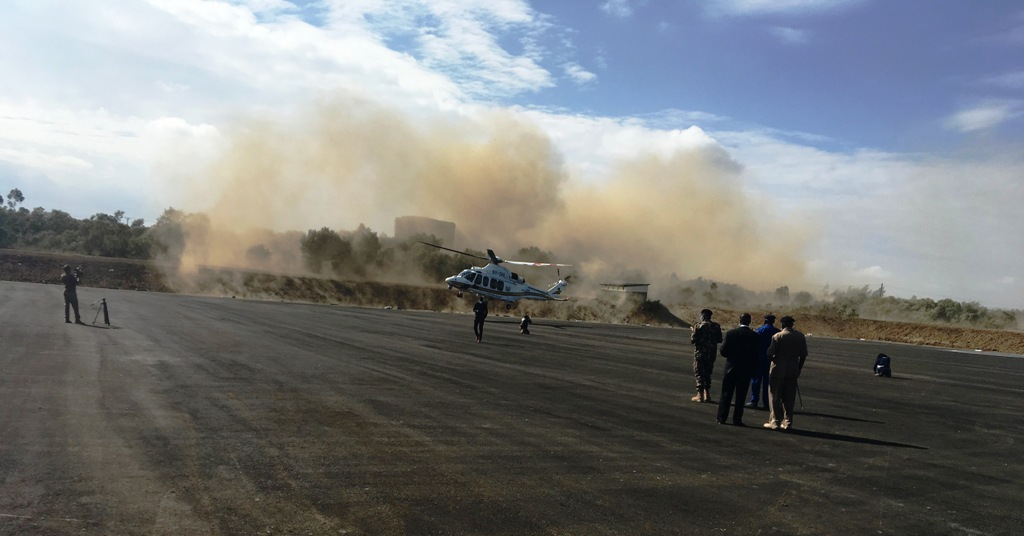 A Kenya Police Airwing helicopter blows dust while manouvering at the WRC Safari Rallly Service Park at Naivasha on Wednesday morning