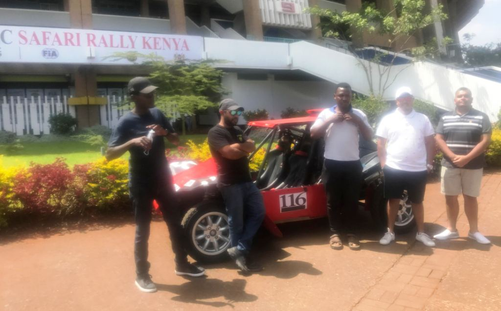 Members of the Oshwal Rally Team in their rally buggy outside Safari Rally headquarters.
