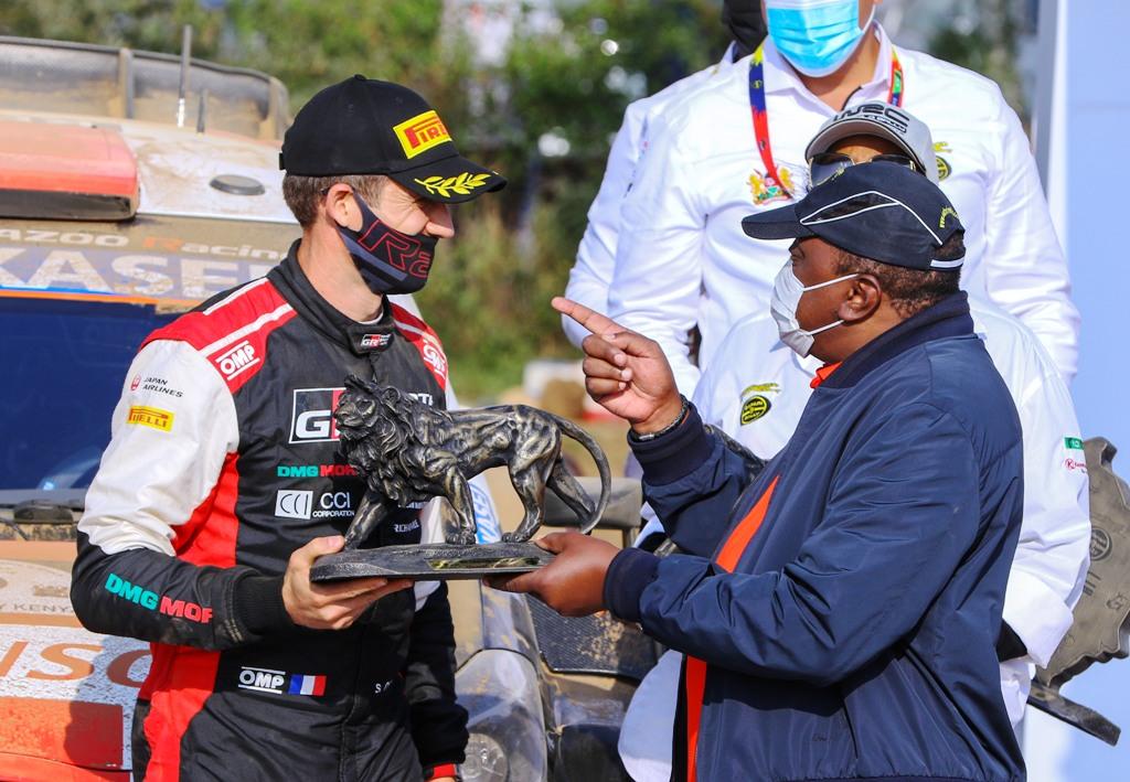 Winner's trophy and congratulations from President Uhuru Kenyatta for Sebastien Ogier. Picture/KEVIN GITIMU